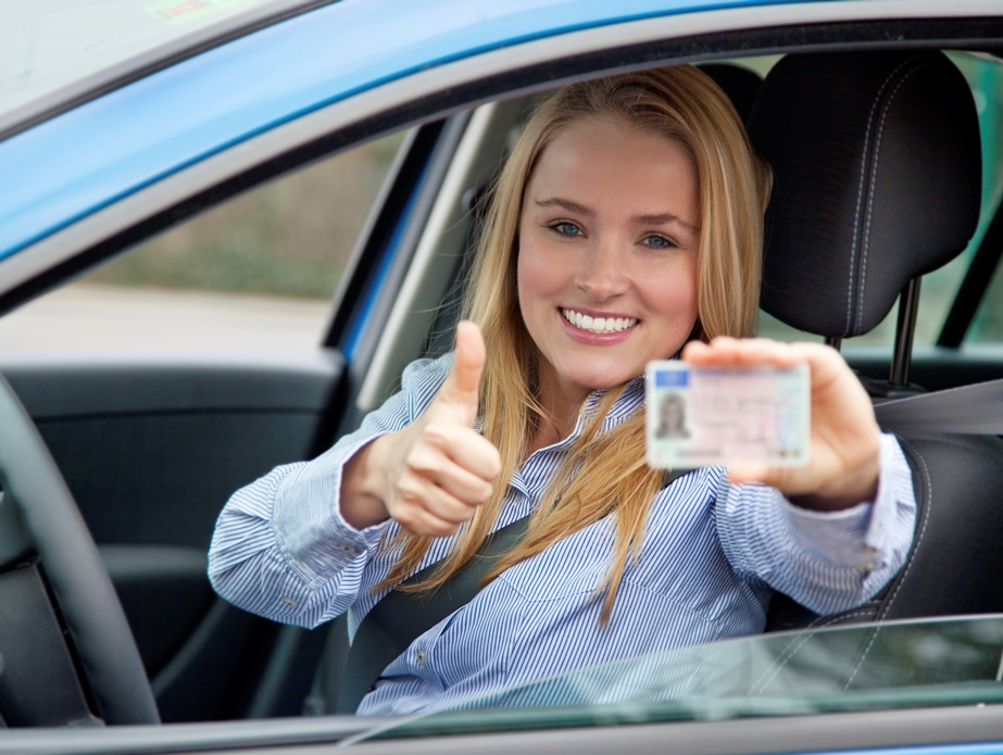 girl smiling with drivers licence