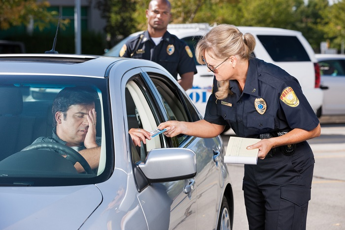 Driver Talking With Officer At Traffic Stop