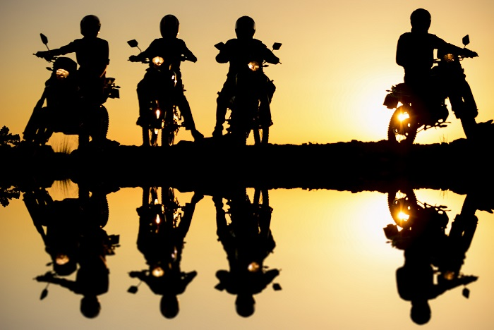 Motorcycle Silhouettes At Sunset